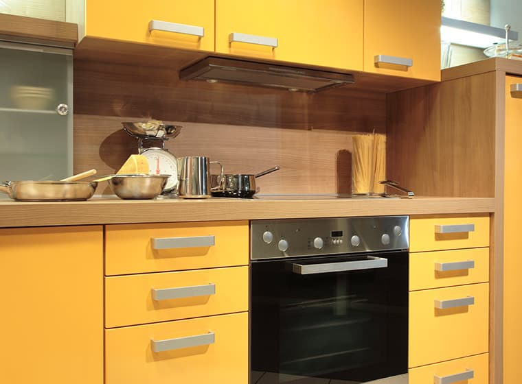 Small Kitchen with yellow cabinets